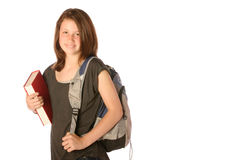 Teen carrying a book and backpack. Teen girl carrying a book and a backpack on an isolated background Royalty Free Stock Image