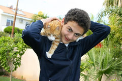 Teen and cat. On his shoulders Royalty Free Stock Image