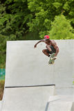 Teen Catches Big Air Skateboarding Off Concrete Ramp Royalty Free Stock Photo