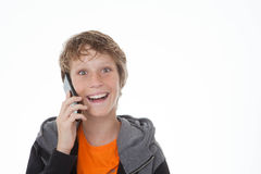 Teen on cell or mobile phone. Teen boy on cell or mobile phone Royalty Free Stock Photos
