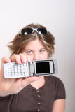 Teen and a cell phone Stock Images