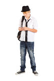 Teen cell phone. Teen boy play with cell phone isolated on white Stock Images