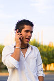Teen cell phone. Teen boy talking in cell phone Royalty Free Stock Photography