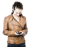 Teen with Cellphone. A teen girl with a cellphone Royalty Free Stock Photos