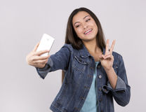 Teen and cellphone Stock Images