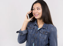 Teen and cellphone Royalty Free Stock Images