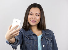Teen and cellphone Stock Image