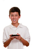 Teen on cellular telephone (cellphone) texting Stock Images