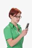 Teen checking her mobile Stock Image