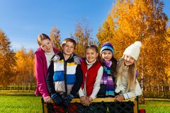 Teen children stand on the bench Stock Photos