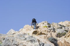 Teen climbing a mountain. Meeting a challenge - adobe RGB Royalty Free Stock Photography