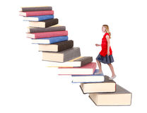 Teen climbing a staircase of books Stock Photo
