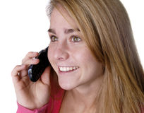 Teen closeup teen girl on cell phone on white back Royalty Free Stock Photography