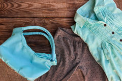 Teen clothing and accessories: shirt, leggings and handbag Stock Images