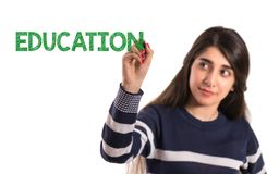 Teen college girl write education on transparent screen royalty free stock images