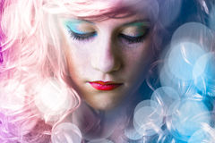 Teen with colored hair, light effects royalty free stock images