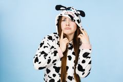 Teen confused girl wearing pajamas cartoon. Teenage confused girl in funny nightclothes, pajamas cartoon style making silly face, woman in doubt, studio shot on Stock Photography