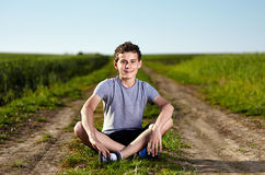 Teen on a countryside road Stock Image