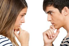 Teen coupe looking at each other wondering. Royalty Free Stock Photos
