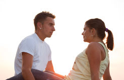 Teen couple. Lovely couple sitting at sunset Royalty Free Stock Photos