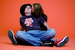 Teen Couple. A teen couple sitting down together stock photos