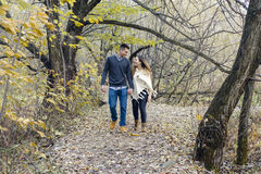 Teen couple at autumn park Stock Photo