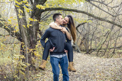 Teen couple at autumn park Stock Photos