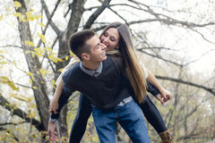 Teen couple at autumn park Royalty Free Stock Photos
