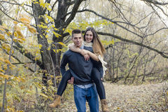 Teen couple at autumn park Royalty Free Stock Photo