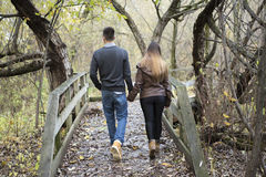 Teen couple at autumn park. A nice teen couple at autumn park royalty free stock photography