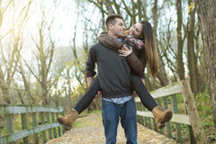 Teen couple at autumn park Royalty Free Stock Photography