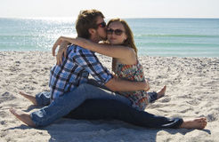 Teen couple on the beach stock images