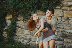 Teen couple bonding, posing together, looking at camera. Stock Images