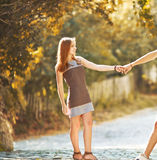 Teen couple bonding, posing together, looking at camera. Royalty Free Stock Images