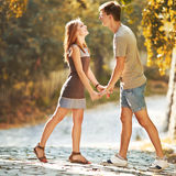 Teen couple bonding, posing together, looking at camera. Stock Photo