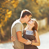 Teen couple bonding, posing together, looking at camera. Royalty Free Stock Image