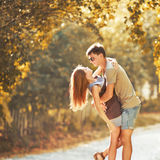 Teen couple bonding, posing together, looking at camera. Stock Photography