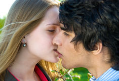 Teen couple date. An attractive couple share a passionate kiss Stock Photo
