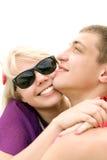 Teen couple embracing. Portrait of caucasian teen couple embracing on the beach stock images