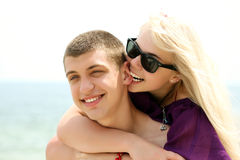 Teen couple embracing. Portrait of caucasian teen couple embracing on the beach stock photo