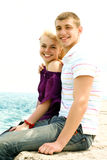 Teen couple embracing. Portrait of caucasian teen couple embracing on the beach stock images