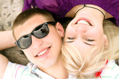 Teen couple embracing. Portrait of caucasian teen couple embracing on the beach royalty free stock image