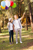Teen couple forest. Cute teen couple in the forest royalty free stock photography