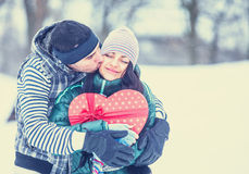 Teen couple with gift Stock Images