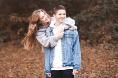 Teen couple. Happy love teen couple having fun outdoors. Wearing stylish denim clothes. Valentines day stock photography