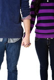 Teen couple holding hands. Close up image of a teen couple holding hands Stock Photography