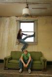 Teen Couple Impoverished Apartment Stock Image