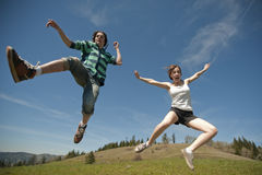 Teen couple jumping Royalty Free Stock Photo