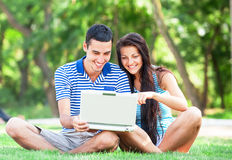 Teen couple with notebook Royalty Free Stock Photo