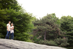 Teen couple in park looking at sky Stock Image